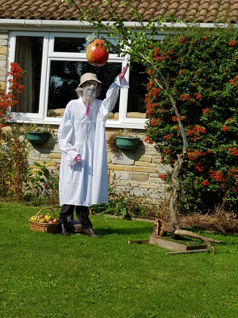 scarecrow picking a large apple